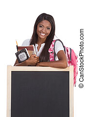 African American College student by blackboard