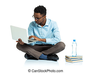 African american college student sitting with laptop on white