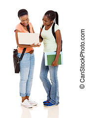 african american college students using laptop computer