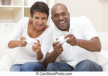 African American Couple Having Fun Playing Video Console Game