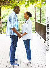 african american couple holding hands
