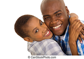african american couple hugging closeup
