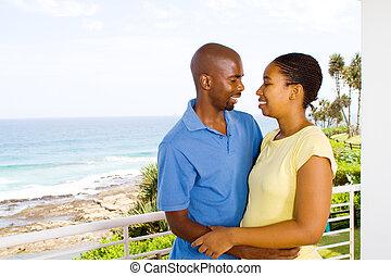 african american couple hugging