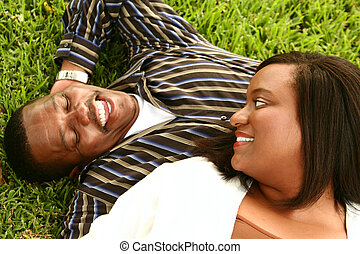 African American Couple Laying On The Grass 2