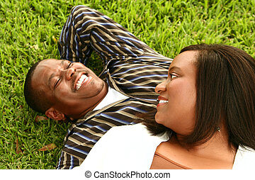 African American Couple Laying On The Grass 3
