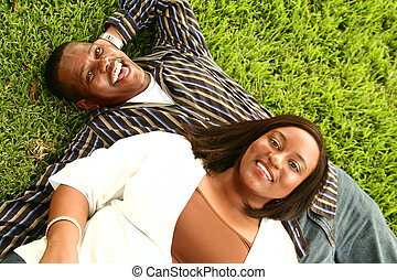 African American Couple Laying On The Grass
