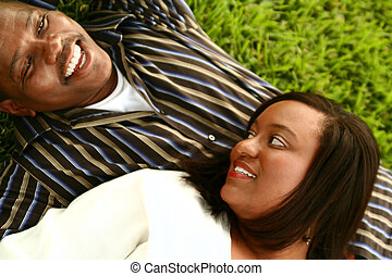 African American Couple Laying On The Ground