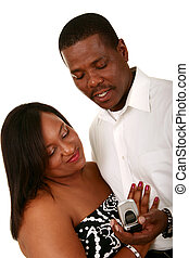 African American Couple Looking At Cell Phone