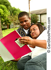 African American Couple Reading Book Outdoor 2