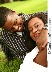 African American Couple Relaxing On The Grass 2