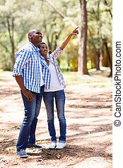 african american couple relaxing outdoors
