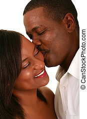 african american husband romantically kiss his wife