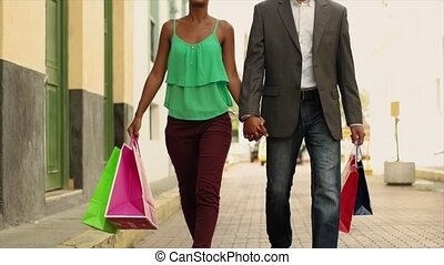 African American Couple Shopping With Bags In Panama City - ...