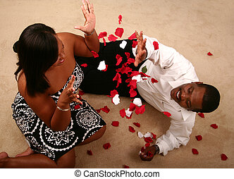 African American Couple Throwing Rose Petal