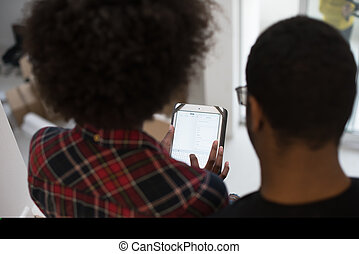 african american couple using tablet at home