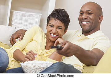 African American Couple Watching Television