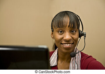 An attractive African American customer support representative, office worker or business woman.