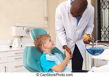 african american doctor handshaking little patient