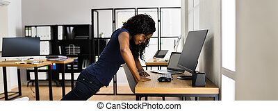 African American Doing Office Exercise Workout