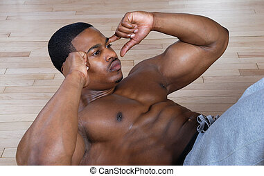 African american doing sit ups