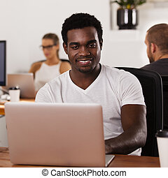 African American entrepreneur in a tech startup office
