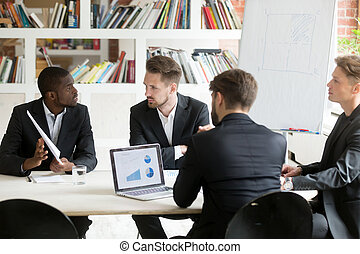 African american expressing ideas to coworkers on briefing