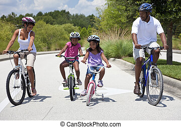 African American Family Parents and Children Cycling