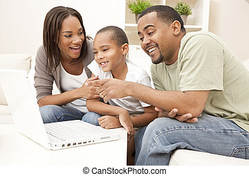 African American Family Using Laptop Computer - African...