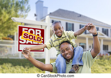 African American Father and Son, Sold Sign and Home
