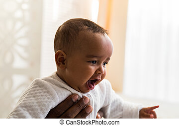 African American Father Playing With mixed race Baby Son