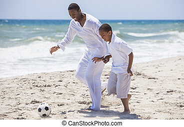 African American Father Son Playing Beach Football Soccer -...