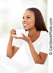 african american female drinking coffee