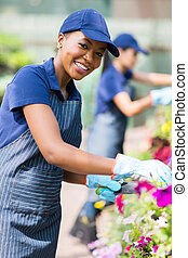 african american female florist in nursery