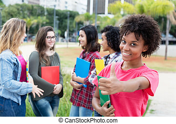 African american female student with group of international students