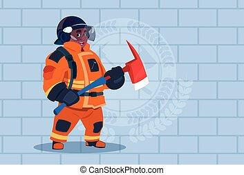 African American Fireman Holding Hammer Wearing Uniform And Helmet Adult Fire Fighter Stand Over Brick Background