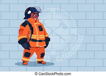 African American Fireman Wearing Uniform And Helmet Adult Fire Fighter Stand Over Brick Background