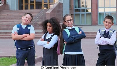 African-American girl and friends cross arms in school yard...
