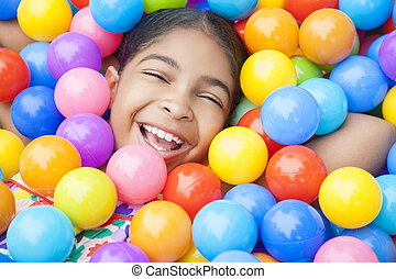 African American Girl Child Colorful Plastic Balls