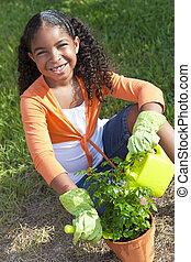 African American Girl Child Gardening Planting Flowers