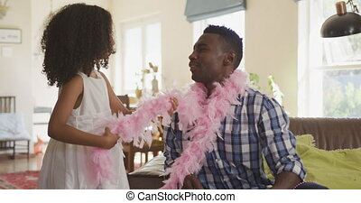 African american girl disguising his father - Front view of ...