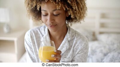 African-American Girl Drinking Juice - Curly with pleasure...