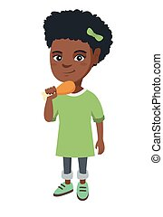 African-american girl eating roasted chicken leg.