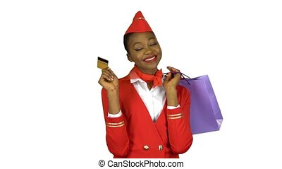 African American girl holding a credit card and packages....