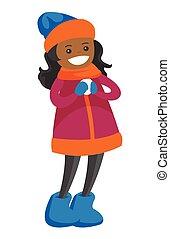 African-american girl holding a little snowball.