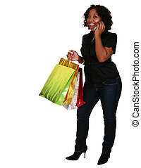 African American Girl Holding Shopping Bags And Phone