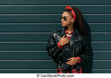 african american girl in leather jacket