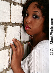 African American Girl Lean Her Face On Brick Wall 2