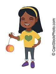 African-american girl playing with yo-yo. Full length of...