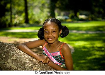 African American Girl Portrait In Park