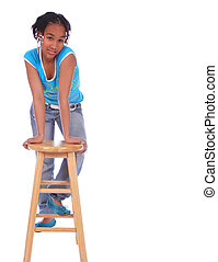 African American Girl Posing With Chair 2